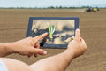 Smart agriculture. Farmer using tablet corn planting. Modern Agr Royalty Free Stock Photo