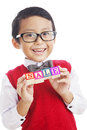 Smart asian boy with a sale sign Stock Image
