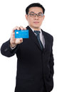 Smart Asian Chinese man wearing suit and holding credit card Royalty Free Stock Photo