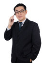 Smart Asian Chinese man wearing suit and holding mobile phone Royalty Free Stock Photo