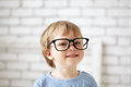 Smart boy with glasses indoors Stock Photo