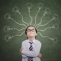 Smart boy thinking many ideas with on the classroom Royalty Free Stock Images
