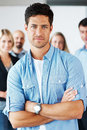 Smart business man standing confidently Stock Images