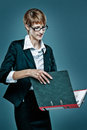 Smart business woman handling a folder with documents on blue background Stock Photos