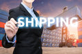 stock image of  Smart business woman is writing shipping word