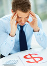 Smart businessman suffering from headache Stock Images