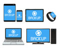 Smart device and computer backing up data Royalty Free Stock Photo