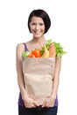 Smart girl with the packet of fruit and vegetables Royalty Free Stock Images