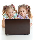 Smart girlfriends are smiling at the laptop Royalty Free Stock Photo