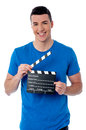 Smart guy holding clapperboard happy young man Stock Images