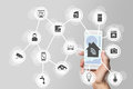 Smart home automation concept illustrated by modern smart phone to monitor smart objects Stock Photo