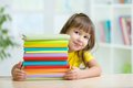 Smart kid girl preschooler with books in primary school Royalty Free Stock Photos