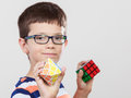 Smart kid little boy with magic rubik cube. Royalty Free Stock Photo