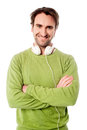 Smart male with headphones around his neck confident young man Royalty Free Stock Photos