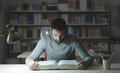 Smart man studying at night Royalty Free Stock Photo