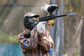 Smart paintball shooter outdoors in summer Royalty Free Stock Photo