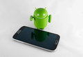 Smart phone and android samsung note robot Royalty Free Stock Images