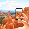 Smart phone camera taking photo bryce canyon picture of nature closeup of mobile screen photographing beautiful Stock Images