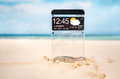 Smart phone with a transparent display futuristic copy space in the sand on the beach concept actual future innovative Royalty Free Stock Photography