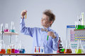 Smart school boy looks at reagents in test tubes close up Royalty Free Stock Image