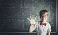 Smart schoolboy genius boy in red glasses near blackboard with formulas Royalty Free Stock Photography