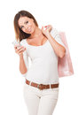 Smart shopper portrait of gorgeous brunette woman shopping using her smartphone Stock Photo