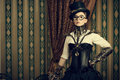 Smart steampunk portrait of a beautiful woman over vintage background Royalty Free Stock Photo