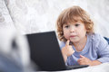 Smart toddler girl using her laptop computer, child and technolo Royalty Free Stock Photo