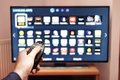 Smart tv UHD 4K controled by remote control. Royalty Free Stock Photo