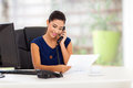 Smart young businesswoman telephone reading report Stock Image
