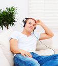 Smart young man listening to music Royalty Free Stock Image