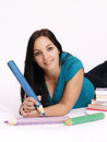 Smart young woman holding big pencil Royalty Free Stock Photo