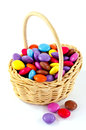 Smarties in a basket colorful sugar coated chocolate candies Royalty Free Stock Photo