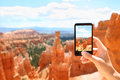 Smartphone camera phone taking photo bryce canyon picture of nature closeup of mobile screen photographing beautiful Stock Images