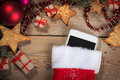 Smartphone in a Christmas sock Royalty Free Stock Photo