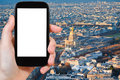 Smartphone with cut out screen and Paris cityscape Royalty Free Stock Photo