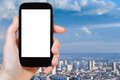 Smartphone with cut out screen and Paris panorama Royalty Free Stock Photo