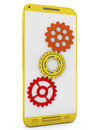 Smartphone with gears on display yellow multicolored the white background Royalty Free Stock Photos