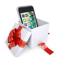 Smartphone in the gift box with red ribbons Royalty Free Stock Image