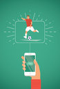 Smartphone in hand with Play button. Football / Soccer player kick on ball.