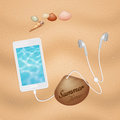 Smartphone with headphones earphones on the beach