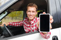 Smartphone man driving car showing app on screen display smiling happy male driver using g apps blank empty touchscreen Royalty Free Stock Photos