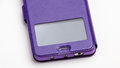 Smartphone in a purple leather case Royalty Free Stock Photo