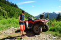 Smartphone Selfie by Generation Y Teenager with ATV (All Terrain Vehicle) Parked in Mountainous Forest Valley Royalty Free Stock Photo