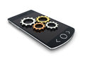 Smartphone setup concept with gears Royalty Free Stock Image