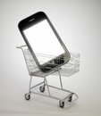 Smartphone in a shopping cart Royalty Free Stock Photography