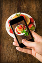 Smartphone shot food photo pancakes with fresh strawberries Stock Image