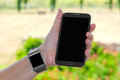 Smartwatch and phablet in hand Royalty Free Stock Photo