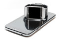 Smartwatch and phablet isolated with black screen over a as the concept of portable technology Royalty Free Stock Image