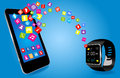 Smartwatch and smart phone with colorful application icons sharing Stock Photos